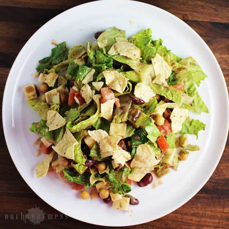 This southestern chopped salad, with two kinds of beans, cubes of cheese, crunchy greens, and a tangy balsamic vinaigrette makes an easy weeknight meal.