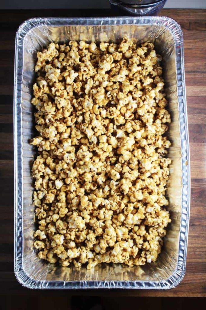 Homemade caramel corn in a large rectangular aluminum pan