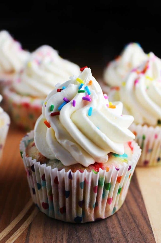Homemade funfetti cupcakes with vanilla frosting and sprinkles