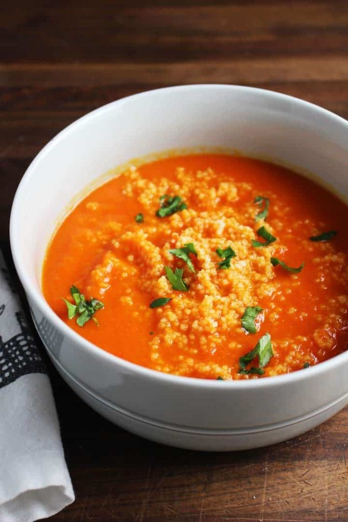 This red pepper carrot soup gets a ton of flavor from harissa, and is extra satisfying on a chilly fall evening with the amazing addition of a couscous swirl.