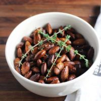 These super simple herbed roasted almonds fromThe Art of Simple Food by Alice Waters of Chez Panisse are perfect to serve with drinks. They're also a great for healthy snacking anytime.#ChezPanisse #herbedalmonds #roastednuts #healthysnack