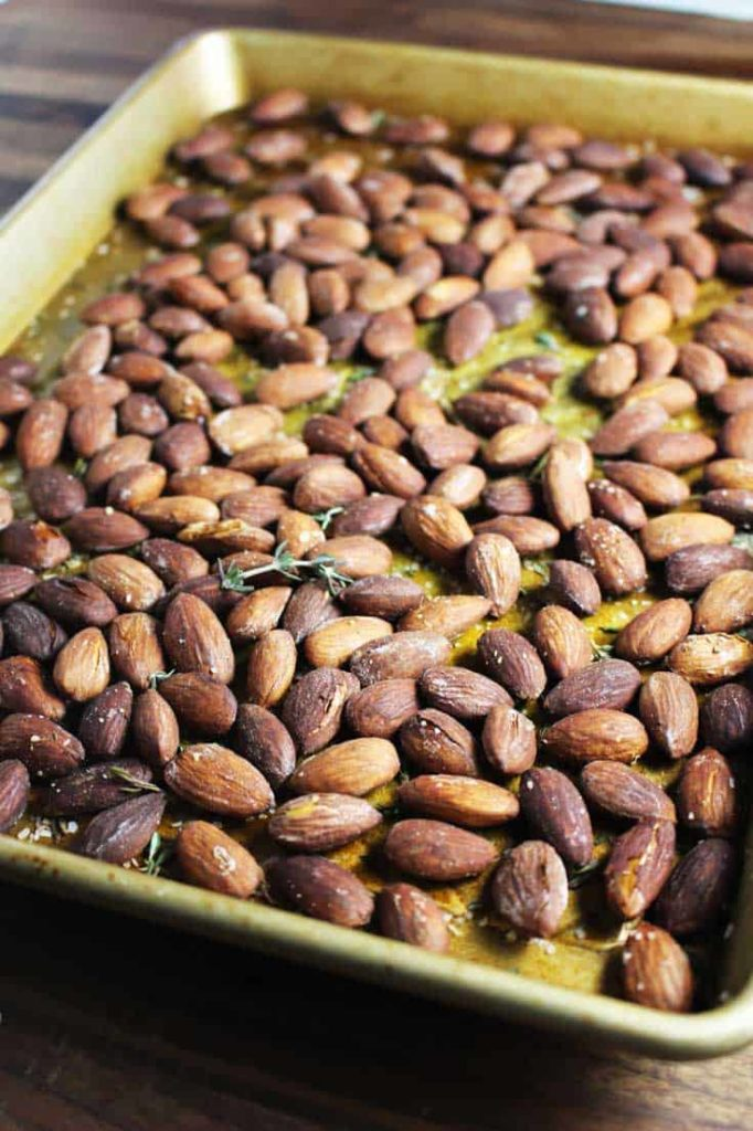 Roasted almonds on a baking sheet