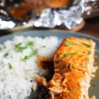 Closeup of sriracha salmon with baked cocount rice on a plate