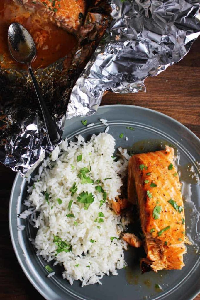 Sriracha salmon with baked coconut rice on a plate