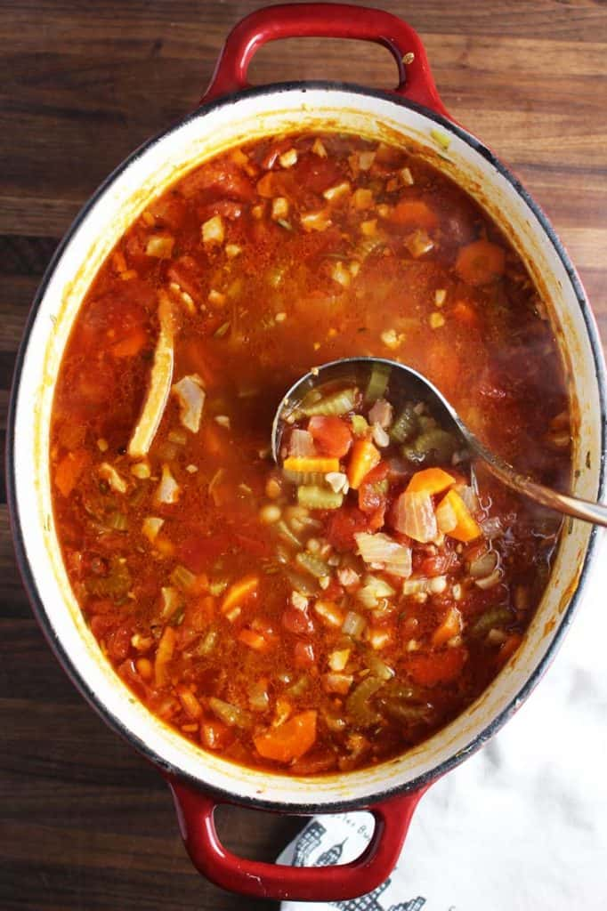Overhead view of a pot of winter minestrone soup
