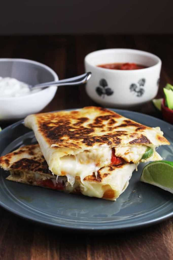 Chicken quesadillas stacked on a plate