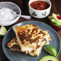 Chicken quesadillas stacked on a plate (overhead view)