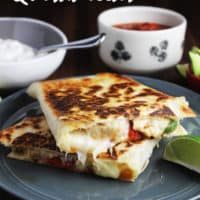 Chicken quesadillas stacked ion a plate