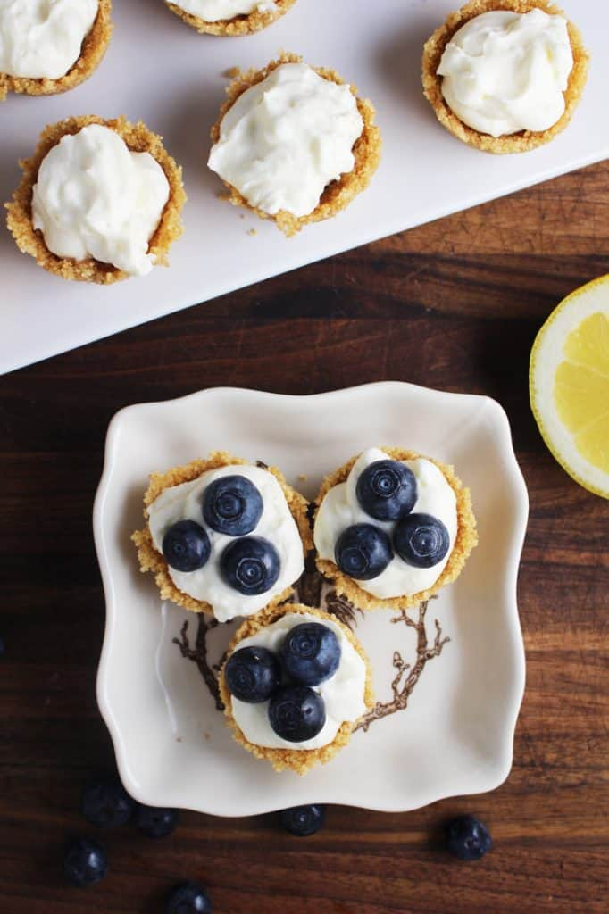 mini cheesecake tarts garnished with blueberries on a plate