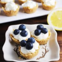 With a light and tangy lemon cheesecake filling, these adorable mini cheesecake tarts are a perfect bite-size treat for any spring or summer celebration. They come together quickly, with no baking necessary, and can be garnished with any fruit you like! #dessert #cheesecake #dessertrecipes
