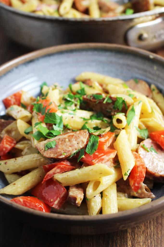 Closeup of a bowl of sausage and vegetable pasta skillet