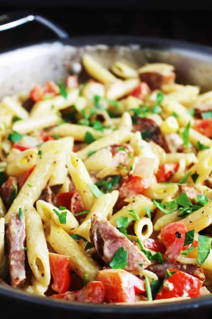 Closeup of vegetable and sausage pasta skillet in a bowl