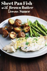 Fish, green beans and potatoes on a plate from sheet pan dinner