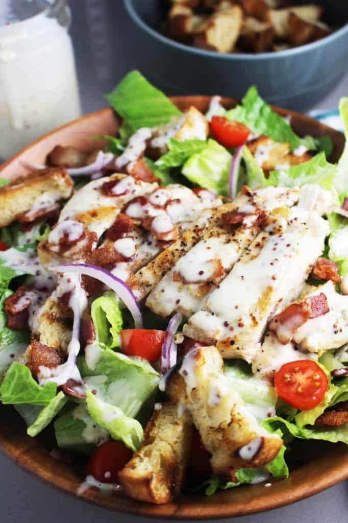 Close up view of club sandwich salad with chicken