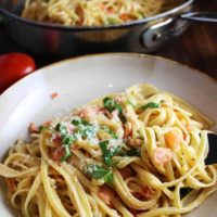 Linguine with fresh tomato cream sauce in a bowl