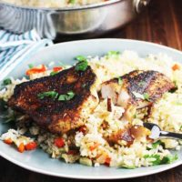 Cajun blackened fish recipe on a plate with rice