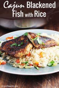 Blackened fish recipe over rice, on a plate