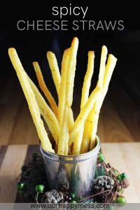 spicy cheese straws in a silver glass