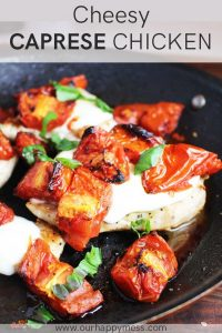 chicken caprese with tomatoes, mozzarella and basil in a non-stick pan