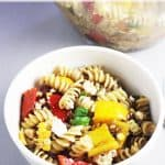 Summer pasta salad with grilled vegetables in a bowl