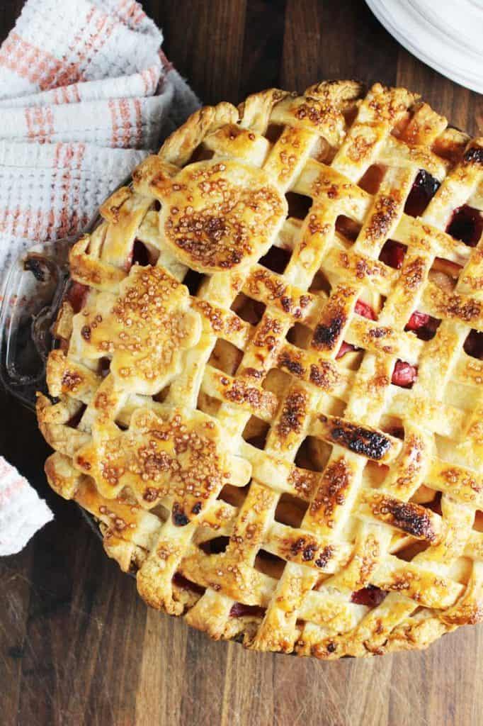 A whole apple cranberry pie with a lattice crust