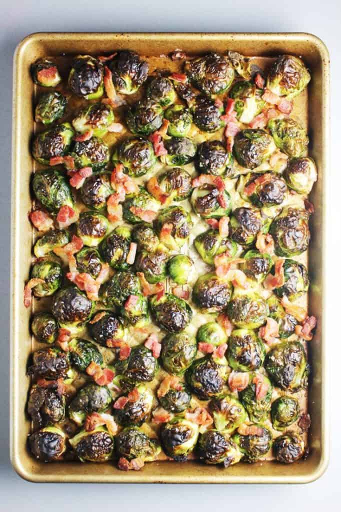 Roasted Brussels Sprouts with bacon on a baking sheet
