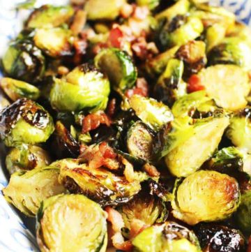 Roasted Brussels Sprouts with maple syrup, balsamic vinegar and bacon in a serving dish