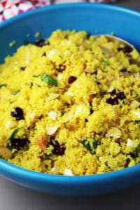 closeup of curried couscous salad in a blue serving bowl
