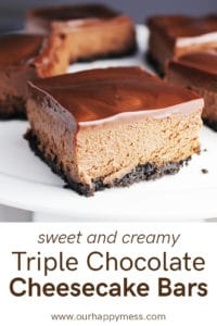 A triple chocolate cheesecake bar on a white plate with more bars in the background