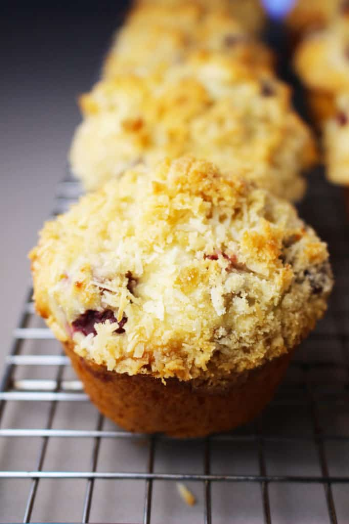 Cherry muffins with coconut streusel cooling on a wire rack