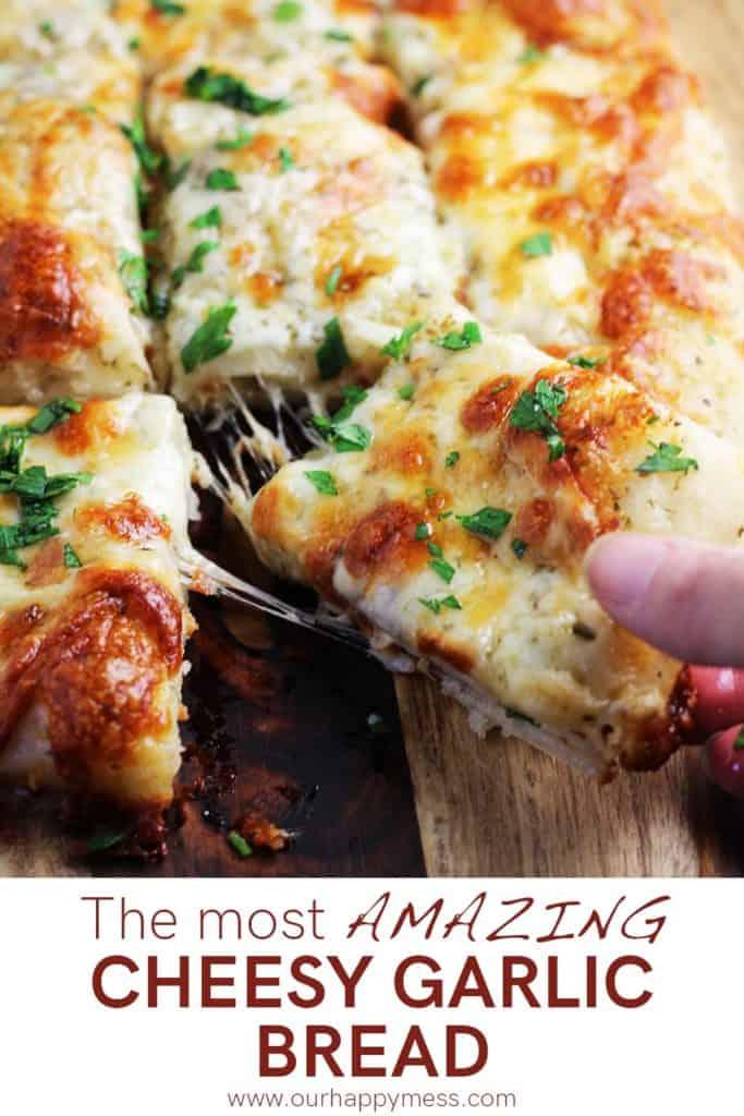 Cheese garlic bread sticks being pulled apart