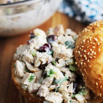 Cranberry walnut chicken salad inside a sesame seed kaiser roll