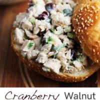 Cranberry walnut chicken salad inside a sesame seed kaiser roll