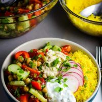 A Mediterranean Buddha bowl with vegetables, couscous, hummus and tzatziki
