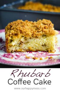 A piece of rhubarb coffee cake with streusel in a decorative plate
