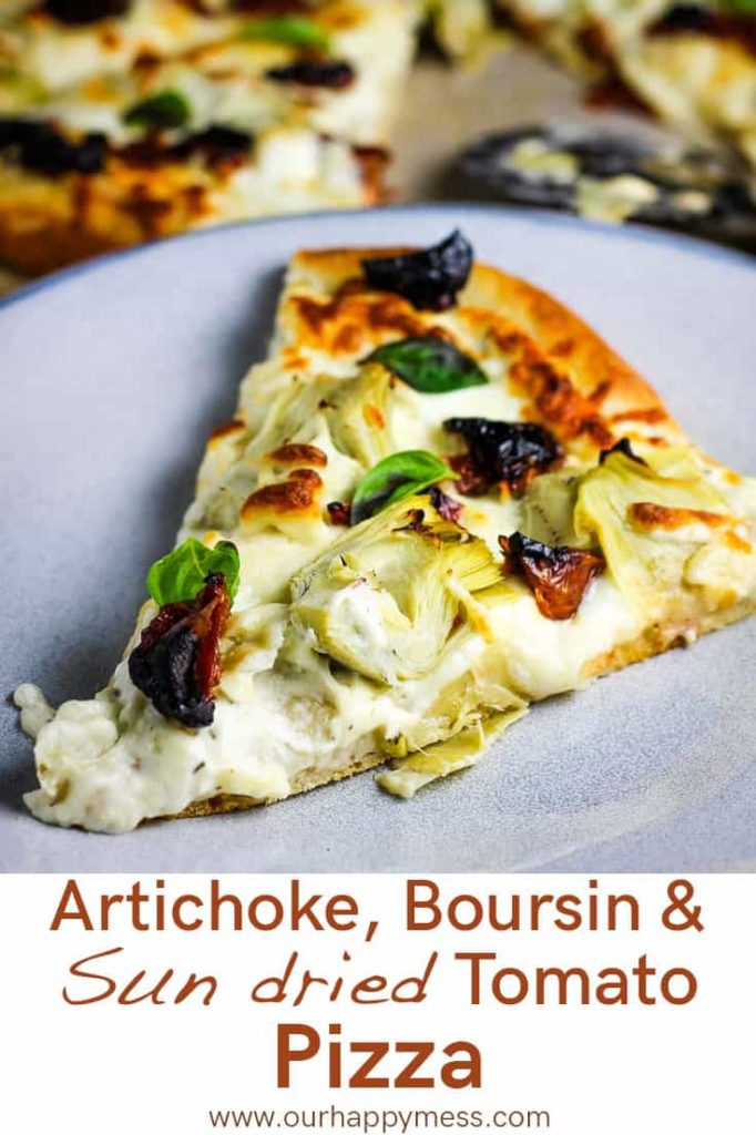 A slice of artichoke pizza on a plate