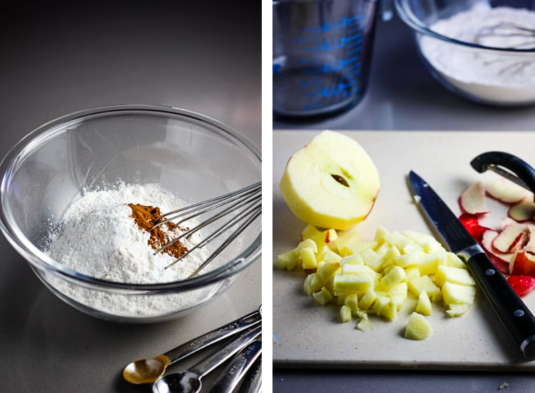 A bowl of flour and other dry ingredients for making a cake, with a whisk, and an apple being cut into chunks on a cutting board