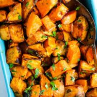 Roasted sweet potato chunks in a baking dish