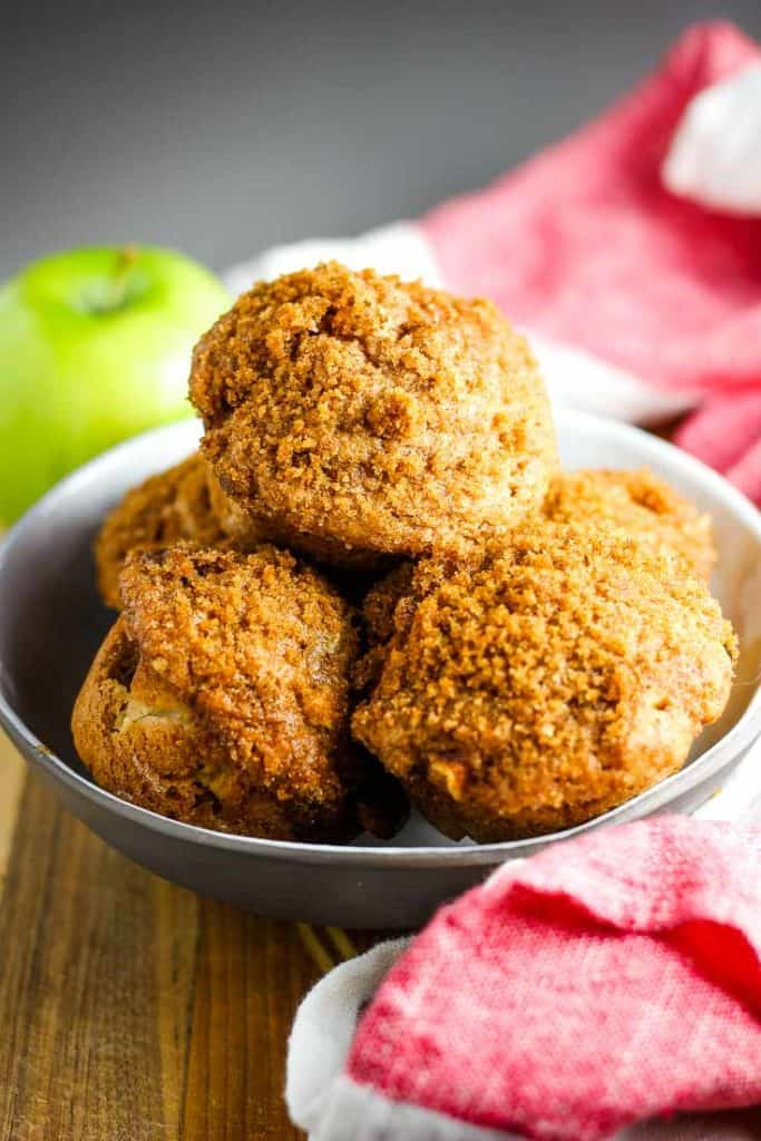 Apple cinnamon muffins piled into a bowl