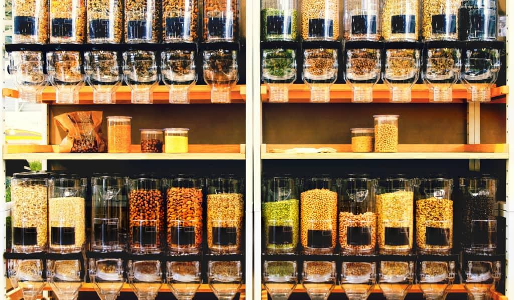rows of bulk bins in a grocery store