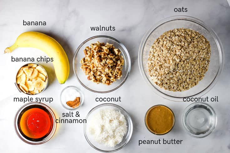 Labeled ingredients for making banana granola in little bowls