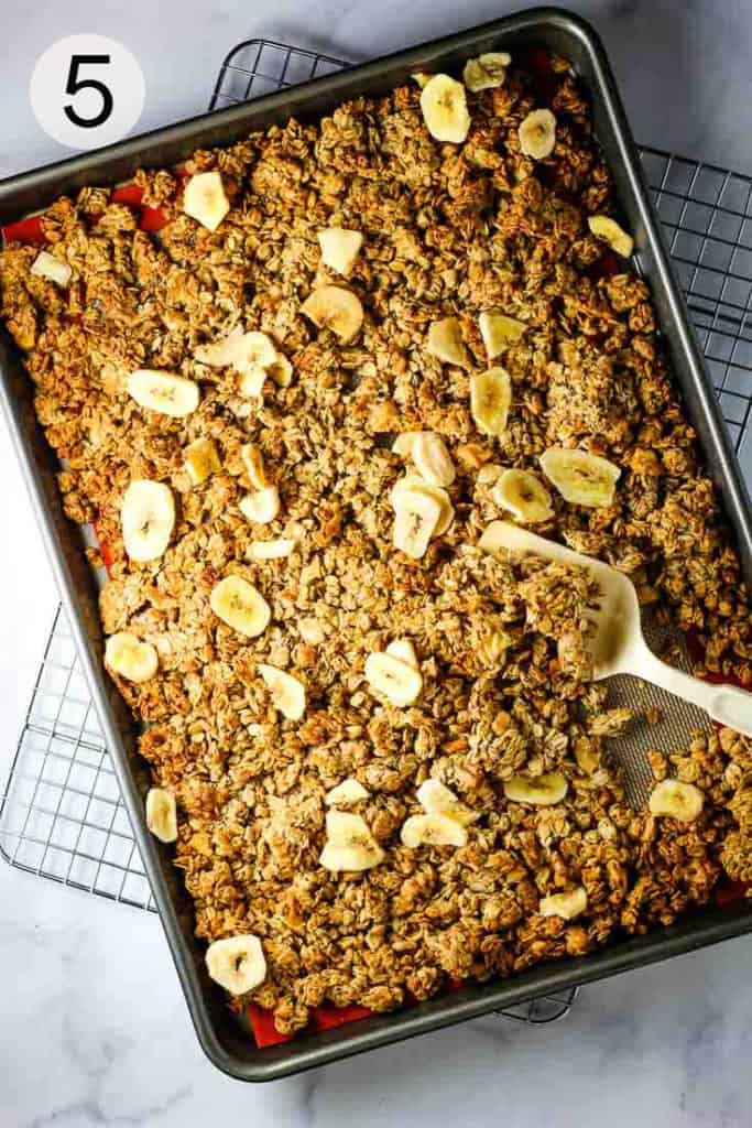 Homemade granola on a baking sheet with banana chips