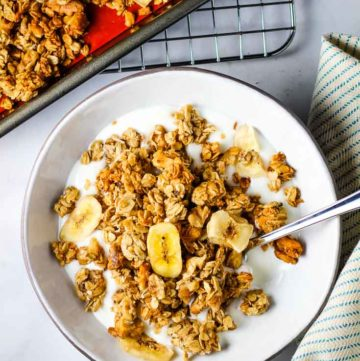 A bowl of banana granola over vanilla yogurt