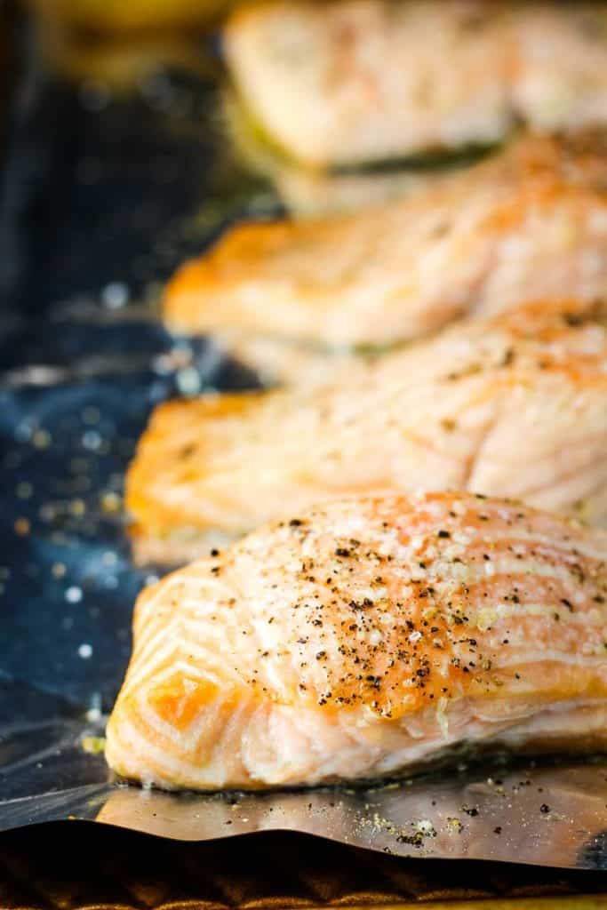 Roasted salmon fillets on a baking sheet