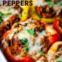 Vegetarian stuffed peppers in a baking dish with text overlay