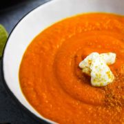 A bowl of carrot ginger soup with a dollop of yogurt