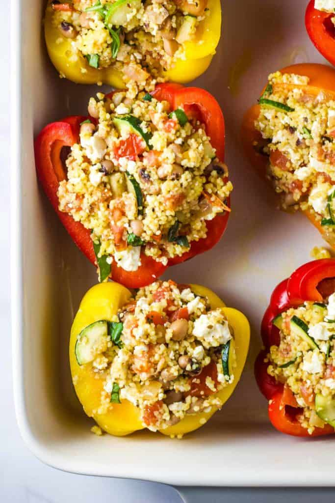 Uncooked stuffed peppers in a baking dish