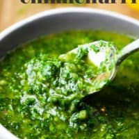 A bowl of chimichurri with a spoon in it and text overlay