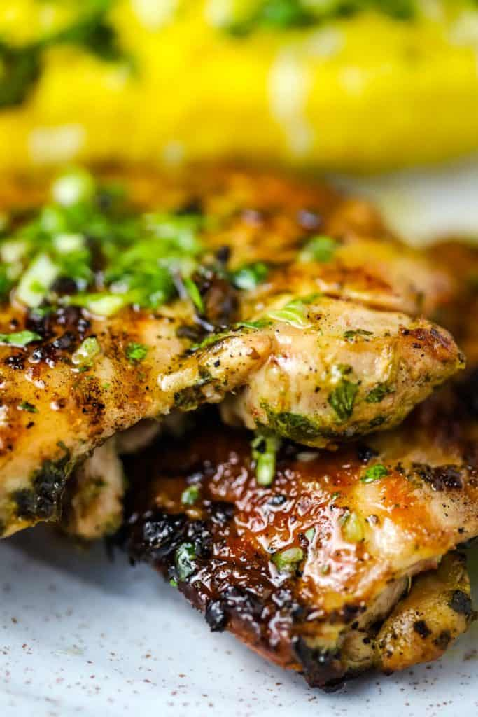 Grilled Chicken thighs topped with chimichurri on a plate