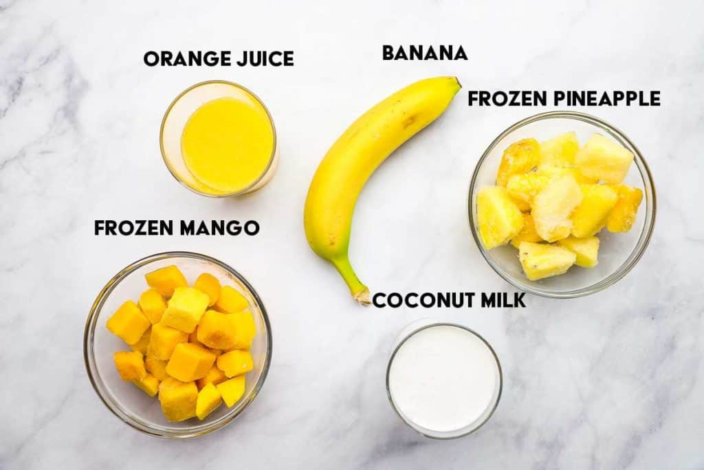 Labeled ingredients for making mango pineapple smoothies.